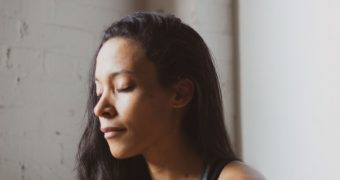 Woman using meditation to help deal with the stress of divorce.