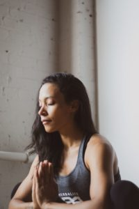 Woman meditating to help deal with stress of divorce.